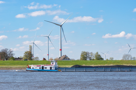 Wind Turbines on the Elbe in Lower Saxony with Cargo Vessel
