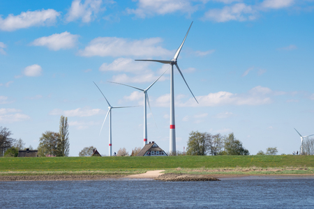 Wind Turbines on the Elbe with Farm house in Germany, Lower Saxony Editorial