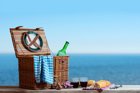 Picnic for two Persons with White Wine at the Sea