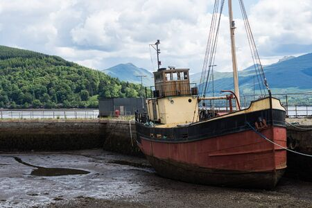Loch Fyne with pier and boat at Inveraray, Scotland