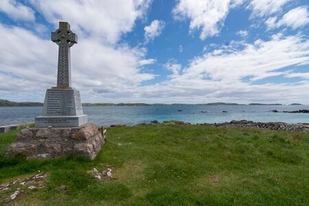 Marble Celtic cross war memorial on Iona, Scotland