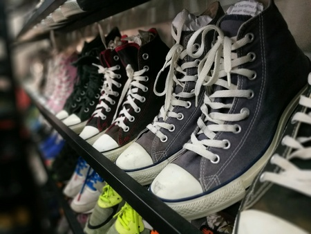 A row of sneakers in flee market Stock Photo