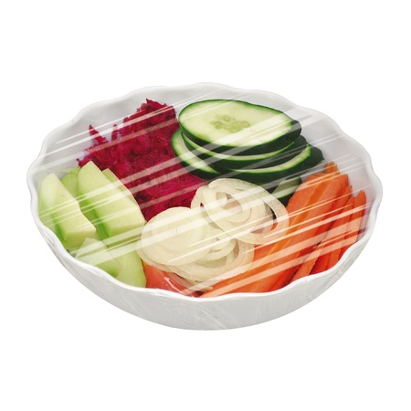 bowl of vegetables and plants protected by plastic film Stock Photo