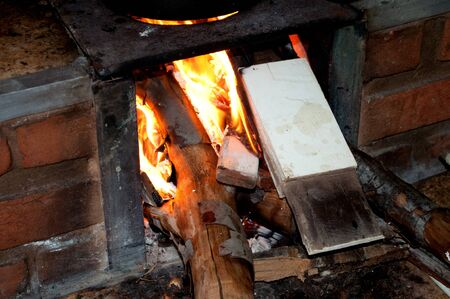 Close of flames on wood stove Stock Photo - 13434358