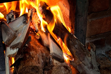 Close of flames on wood stove Stock Photo - 13434360