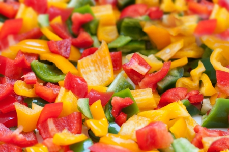a lot of colored cut peppers Stock Photo