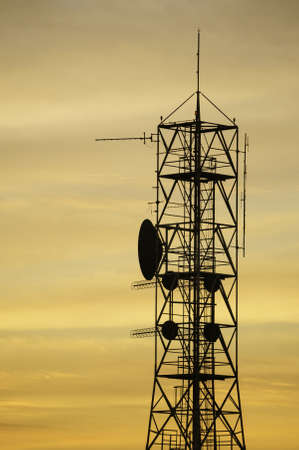 Pretty shot with cell tower on sunrise Stock Photo - 15826175