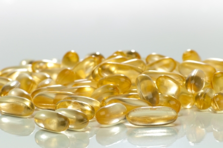 Closeup of group of coconut oil capsules photo