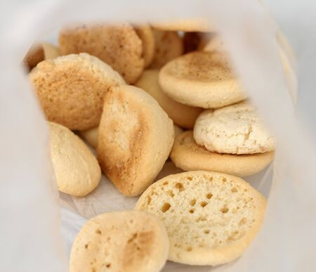 Brazilian Coconut cookies (gluten free) close inside transparent packing