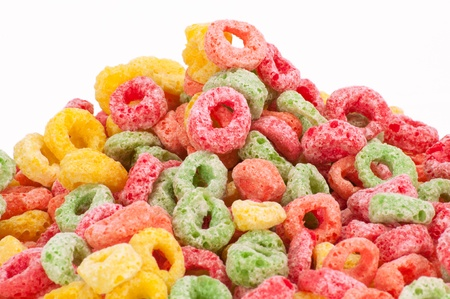 Colorful fruit cereal closeup on white background.