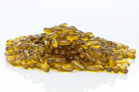Closeup of group of soft gel capsules on white background