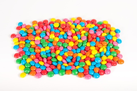 Close up of Sugar Coated Chocolate Buttons  Smarties  on white background Stock Photo