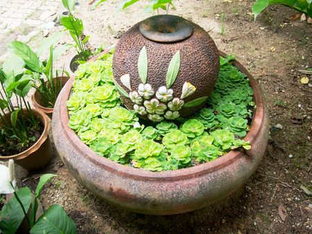 Baked clay jar and sink for decorate garden