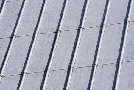 diagonal lines: Close-up of lead sheeting on church roof with strong diagonal lines Stock Photo