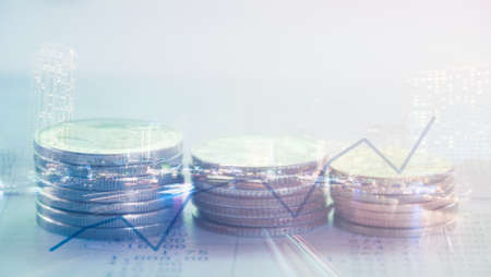 bank statement: Double exposure of city and rows of coins on bank statement with graph,finance and banking concept