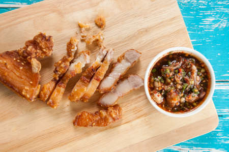 deep fried: Deep fried pork belly  with spicy sauce Stock Photo