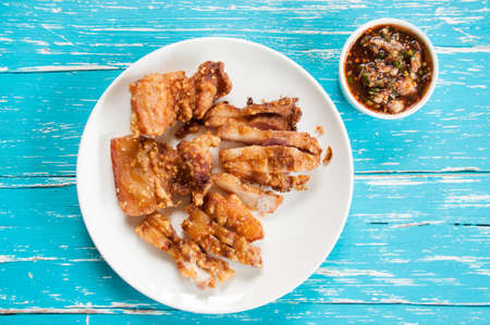 Deep fried pork belly  with spicy sauce Stock Photo