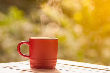 by cu: Red coffee cu on table, relax time Stock Photo