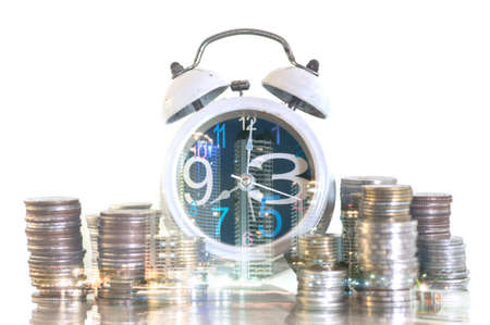 Double exposure coins and alarm clock with city background, Finance and money saving concept Stock Photo