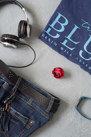 Clothing (t-Shirt, jeans, watches, headphones)
