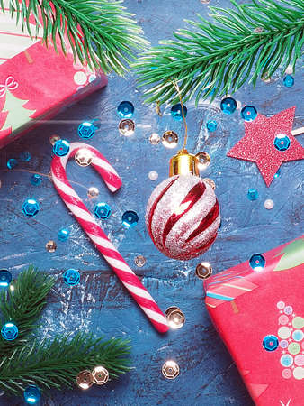 Christmas or New year dark background with seasonal decorations, top view.