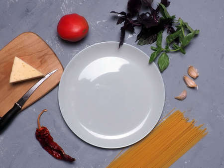 Traditional recipe italian pasta spaghetti with tomato and basil on the gray stone table