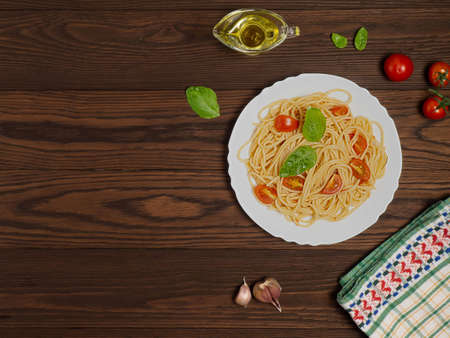 Spaghetti with tomatoes and Basil on a dark wooden background. Healthy diet. Flat lay. Zdjęcie Seryjne