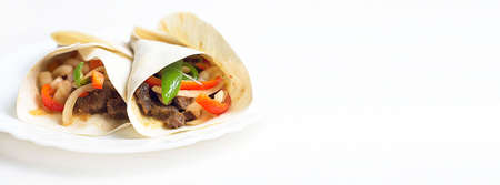 Fajitas with beef and vegetables in a tortilla. Doner, kebab, Shawarma. Banner. Stock Photo