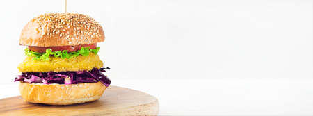 Vegan Burger with chickpea cutlet, cabbage, green salad and tomato on a white background. Healthy diet. Close up. Banner.