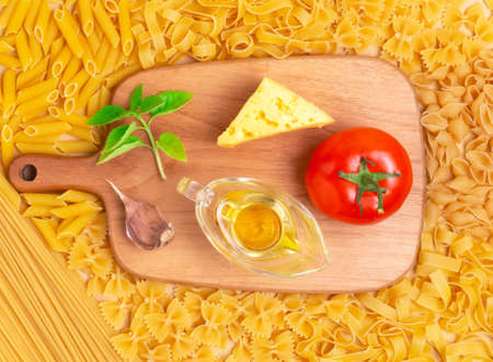 Ingredients for pasta with cheese and vegetables. Different types of pastes.