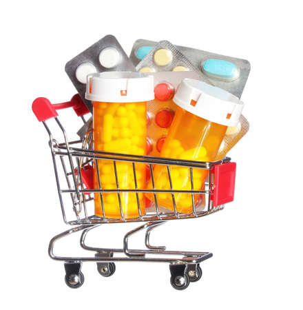 Pill bottle and pills in shopping cart isolated on white  Concept  Pharmacy