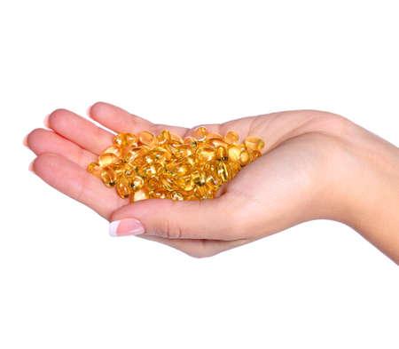 Vitamin A Capsules in Female Hand Omega-3 or Fish Oil Pills