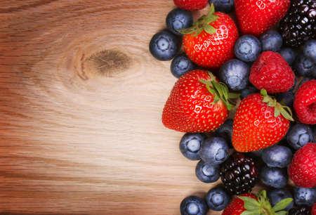 Berries on Wooden Strawberries, Blueberry, Raspberries, and Blackberry  Stock Photo