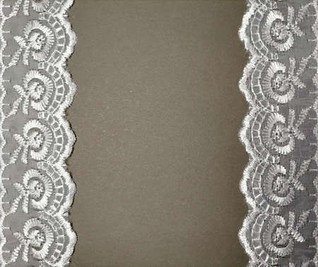 Lace on gray background Imagens
