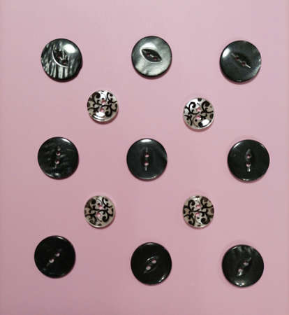 Button pattern on a pink background
