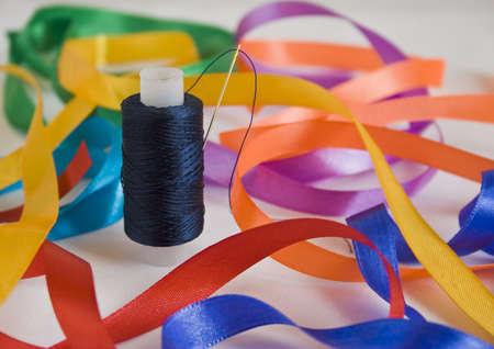 Needle and a thread-closeup