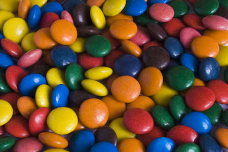Multicolored sweet dragee.  Abstract background.