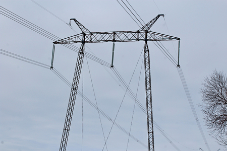On the photo there are electrical supports, 330 kV power transmission lines, metal poles with insulators transmitting huge current over long distances Standard-Bild - 117833882