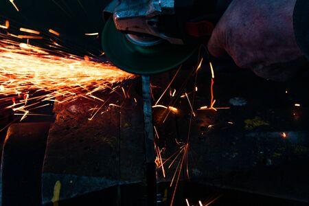work as a grinder, metal cutting, sparks from metal cutting