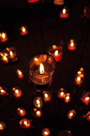 More candle light in the glass photo