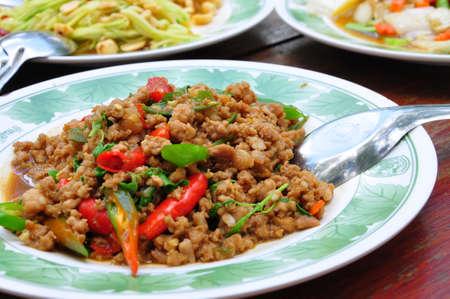 This is spicy pork basil, Thai food photo