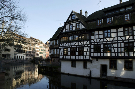fachwerk: Fachwerk medieval cityscape in Strasbourg, timber-framed buildings. Petite France, Ile