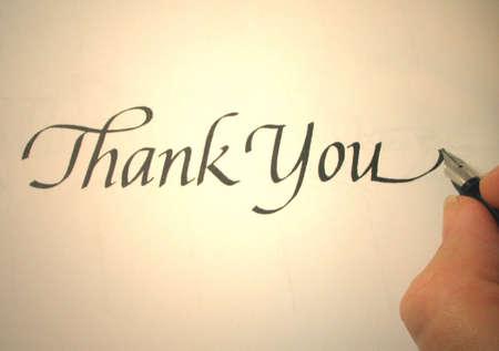 persona escribiendo: Persona gracias escrito en caligraf�a  Foto de archivo