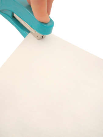 office stapler: blank sheets being stapled, suitable background for inserting text