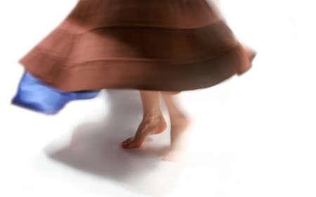 woman dances (focus on foot)