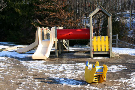 mud and snow: deserted playground in winter