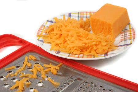 freshly grated cheddar cheese Banco de Imagens