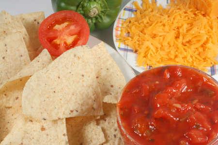 nacho chips, cheese  and salsa