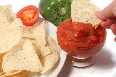 dipping tortillas in salsa photo