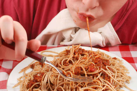 slurp: young teen eating pasta